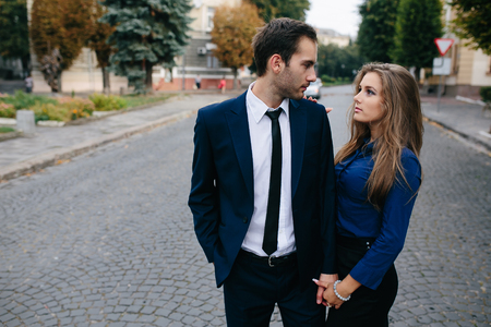 romantic man: man and woman walking together on the street Stock Photo