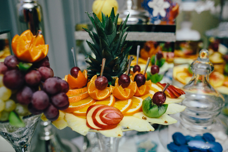 receptions: buffet with tropical fruit on the wedding banquet Stock Photo
