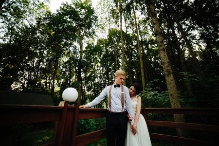 verandah: bride and groom posing on the verandah somewhere in the nature