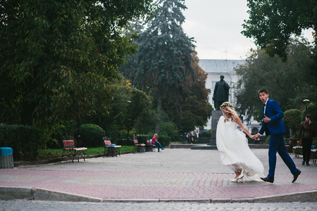 Young wedding couple walking and having fun
