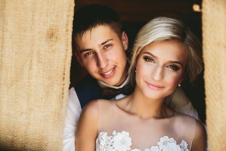 doorway: Beautiful wedding couple posing in the doorway