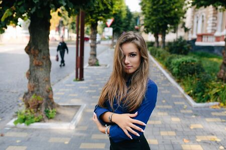 emotional woman: young beautiful girl posing in the street