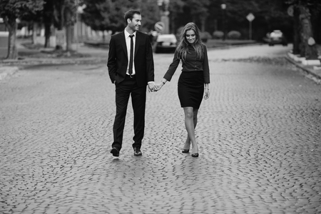 girl dress: man and woman walking together on the street Stock Photo