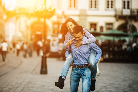 street love: man and woman posing and have fun in the old town Stock Photo