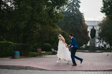 love hands: Young wedding couple walking and having fun