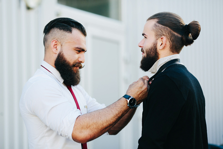 get ready: Two businessman helping each other to get ready Stock Photo