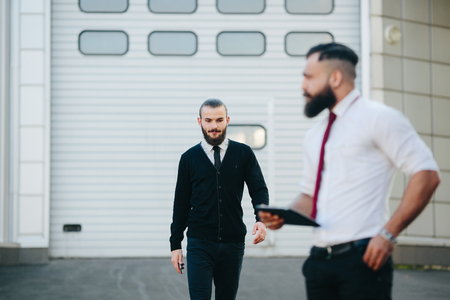 black business men: Two bearded businessman working on the street Stock Photo