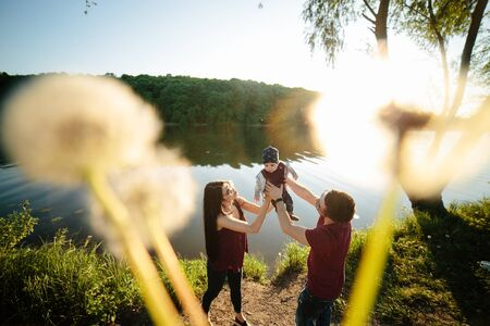 lifestile: young family have fun and relaxing outdoors in the countryside