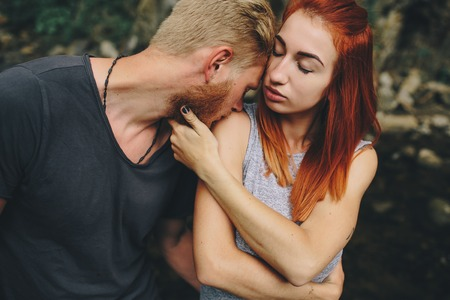 tenderly: man and woman tenderly hugging in nature