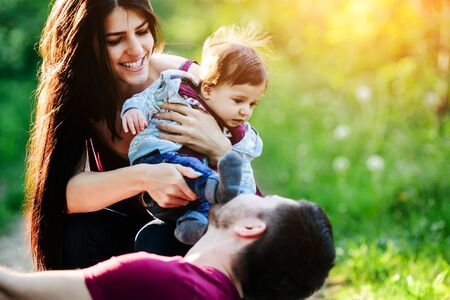 young wife: young family have fun and relaxing outdoors in the countryside