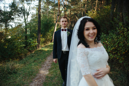 Beautiful wedding couple posing in a forest