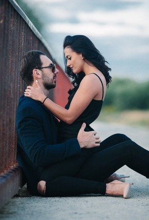 girl sits on a guy and looking at him Stock Photo