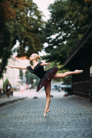camra: Ballerina posing in the center city on the camra