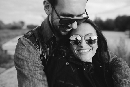 guy hugging tenderly his girlfriend Stock Photo