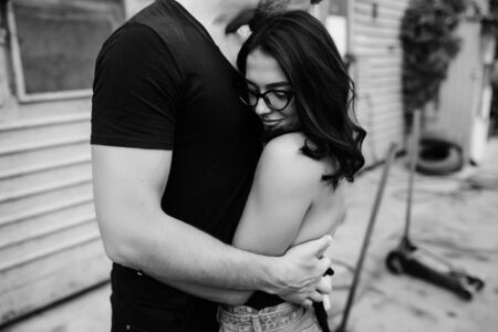 two people with others: guy and girl in each others arms