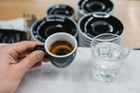 cup of coffee in a hand Stock Photo