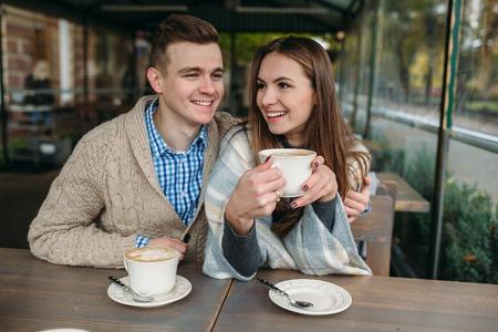 sidewalk talk: Couple sitting at sidewalk cafe