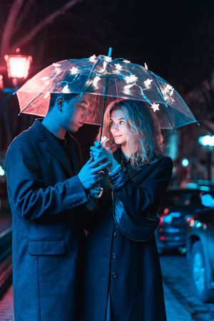 Portrait of a guy and a girl under an umbrella Stock Photo