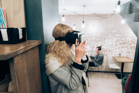 computer simulation: Young girl getting experience VR headset Stock Photo