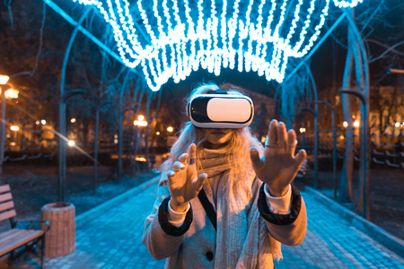 Young girl getting experience VR headset Stock Photo