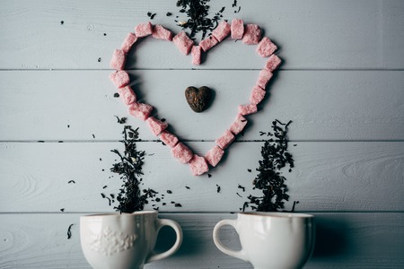 A white mug with pink heart Stock fotó