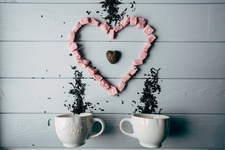 A white mug with pink heart Stok Fotoğraf