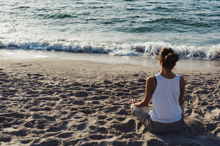 rejuvenated: Young woman practicing yoga Stock Photo