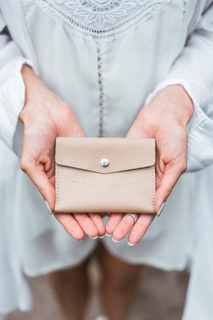 Woman hands hold purse