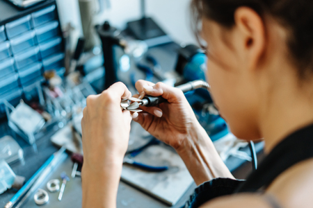 The girl is engaged in jewelry business