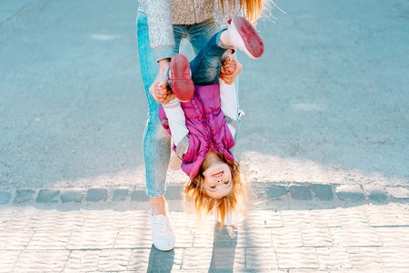 Mom and girl playing, having fun Stock Photo