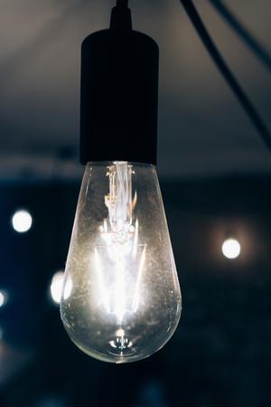 Burning an incandescent edison lamp Imagens - 85880716