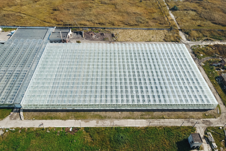 Greenhouses field. Flying over the greenhouses. 版權商用圖片
