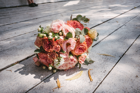 wedding bouquet on the wooden floor Фото со стока