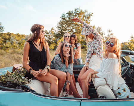 Six girls have fun in the countryside Stock Photo
