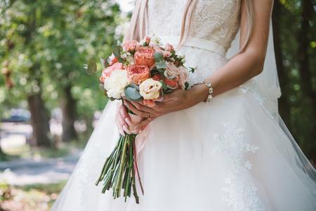 The bridegroom embraces the brides waist,