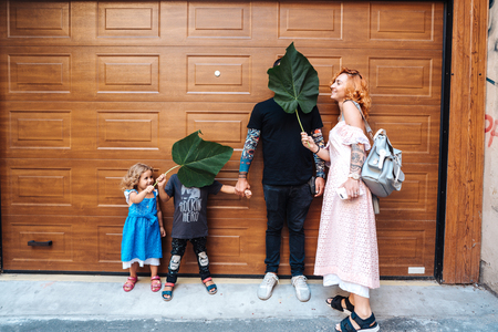Family having fun on the street Stock Photo