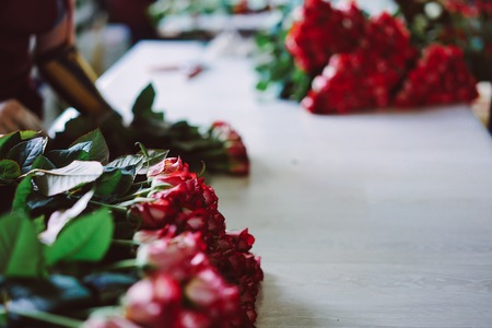 fresh cut red roses lie on the table