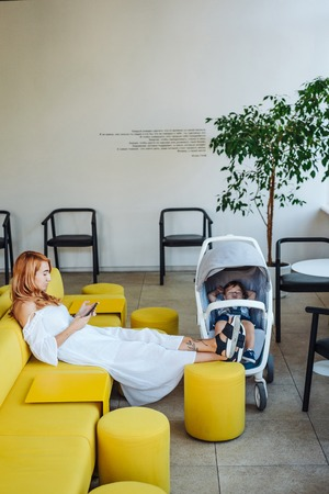 Mom and stroller with her baby