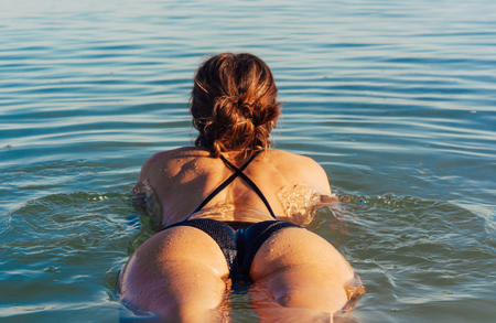 Girl is relaxing and swimming in the water Imagens - 96486503