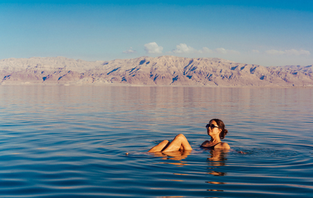 Girl is relaxing and swimming in the water Imagens - 94722183