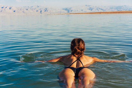 Girl is relaxing and swimming in the water Banco de Imagens - 94722184