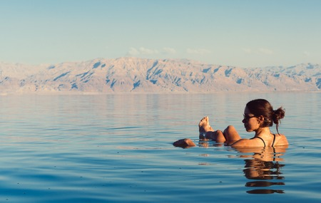 Girl is relaxing and swimming in the water Stock Photo