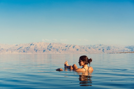 Girl is relaxing and swimming in the water Banco de Imagens