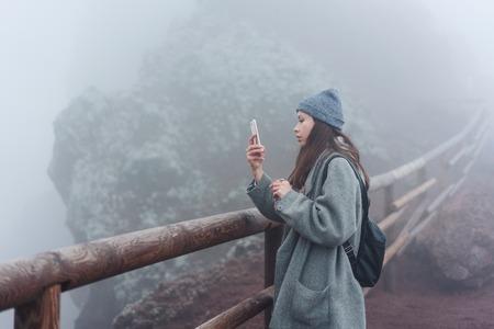 Girl climbs the path to the mountain 版權商用圖片