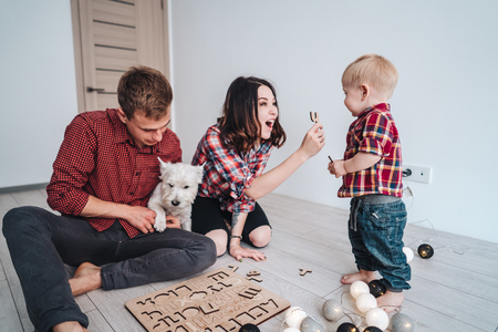 Happy family are playing together on the floor Stock Photo - 102241902