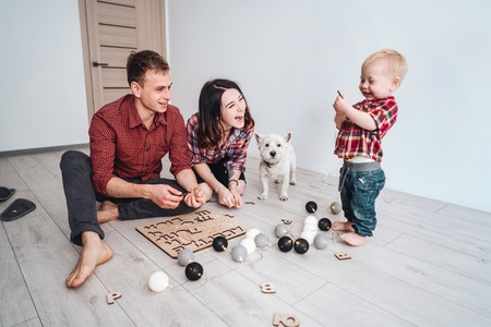 Happy family are playing together on the floor