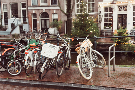 Bicycles lining a bridge over the canals of Amsterdam