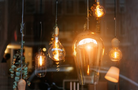 Incandescent lamps in room behind the glass Stock Photo