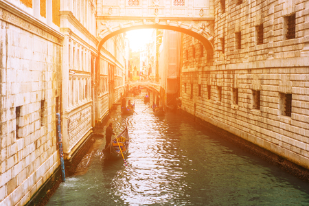 Venetian channel with ancient houses and boats Stock Photo