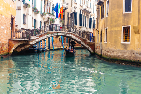 Venetian channel with ancient houses and boats 스톡 콘텐츠 - 104044649